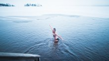Dipping in a frozen lake from the sauna - Laura Vanzo